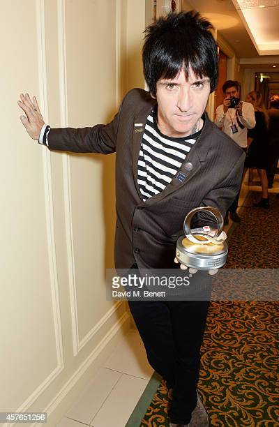 Johnny Marr winner of the Gibson Les Paul award poses in the press room at the Xperia Access Q Awards at The Grosvenor House Hotel on October 22 2014...