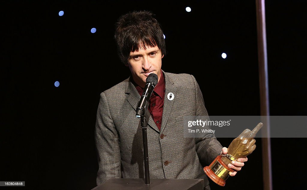 <a gi-track='captionPersonalityLinkClicked' href=/galleries/search?phrase=Johnny+Marr&family=editorial&specificpeople=3947211 ng-click='$event.stopPropagation()'>Johnny Marr</a> wins the Godlike Genius award at the NME Awards 2013 at the Troxy on February 27, 2013 in London, England.