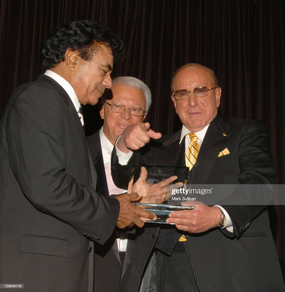 """Johnny Mathis receives the 15th Annual """"Ella"""" Award from Jerry F Sharell and Clive Davis"""