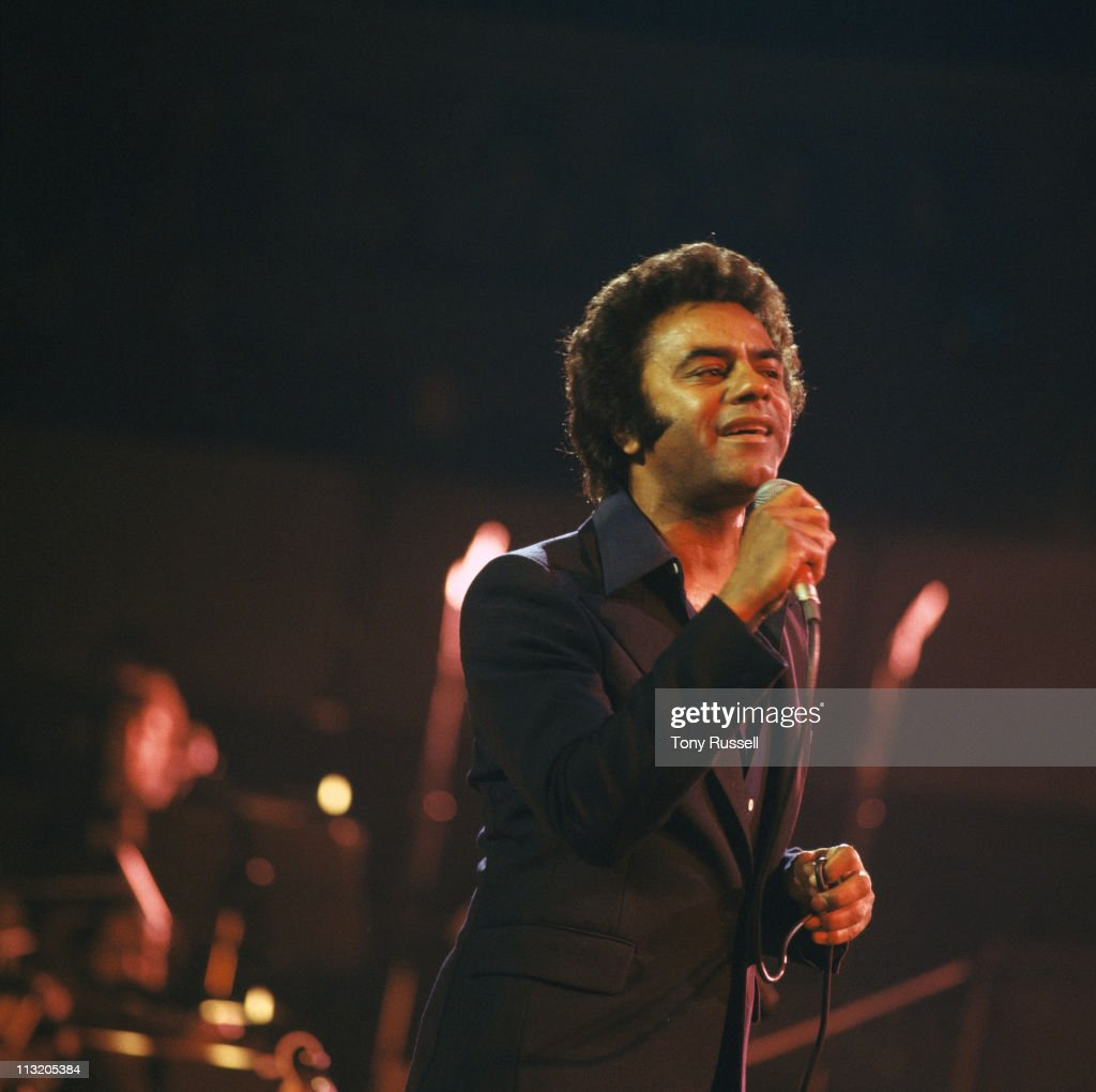 Johnny Mathis US singer singing into a microphone during a live concert performance in London England Great Britain circa 1977