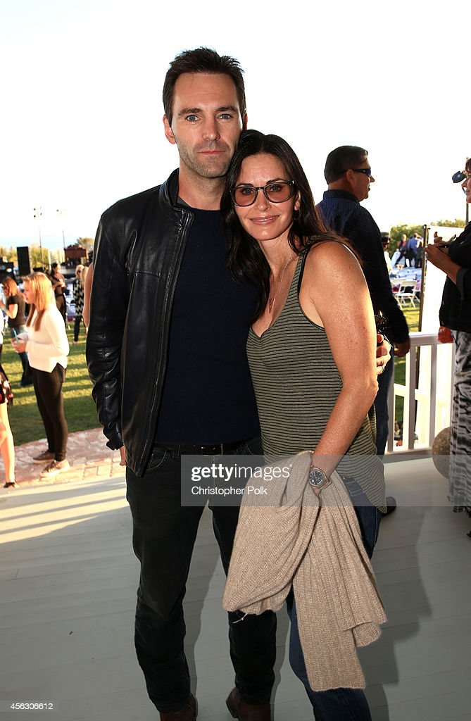 Johnny McDaid and actress Courteney Cox attend Rock4EB, Malibu, with Jackson Browne & David Spade sponsored by Suja Juice & Sabra Hummus at Private Residence on September 28, 2014 in Malibu, California.