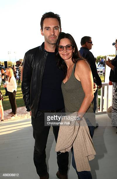 Johnny McDaid and actress Courteney Cox attend Rock4EB Malibu with Jackson Browne David Spade sponsored by Suja Juice Sabra Hummus at Private...
