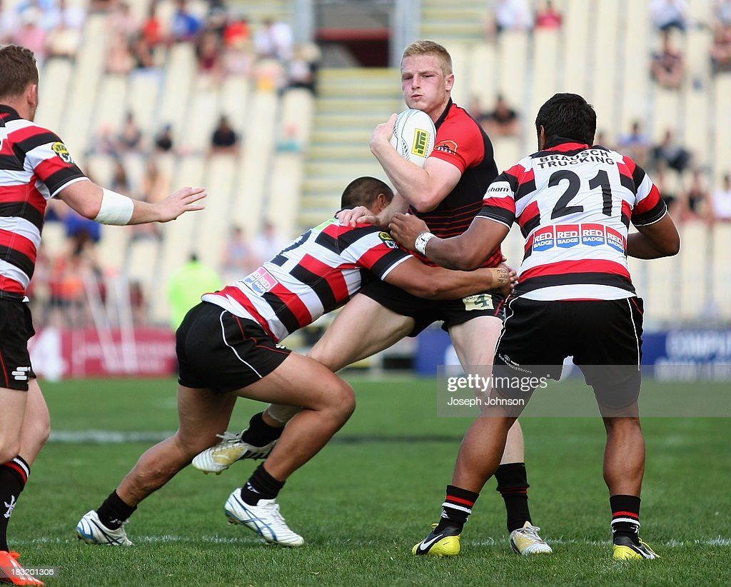 Johnny McNicholl of Canterbury in the tackle of Tyrone Lefau and Ahsee Tuala of Counties Manukau during the round eight ITM Cup match between Cantebury and Counties Manukau at AMI Stadium on October 6, 2013 in Christchurch, New Zealand.