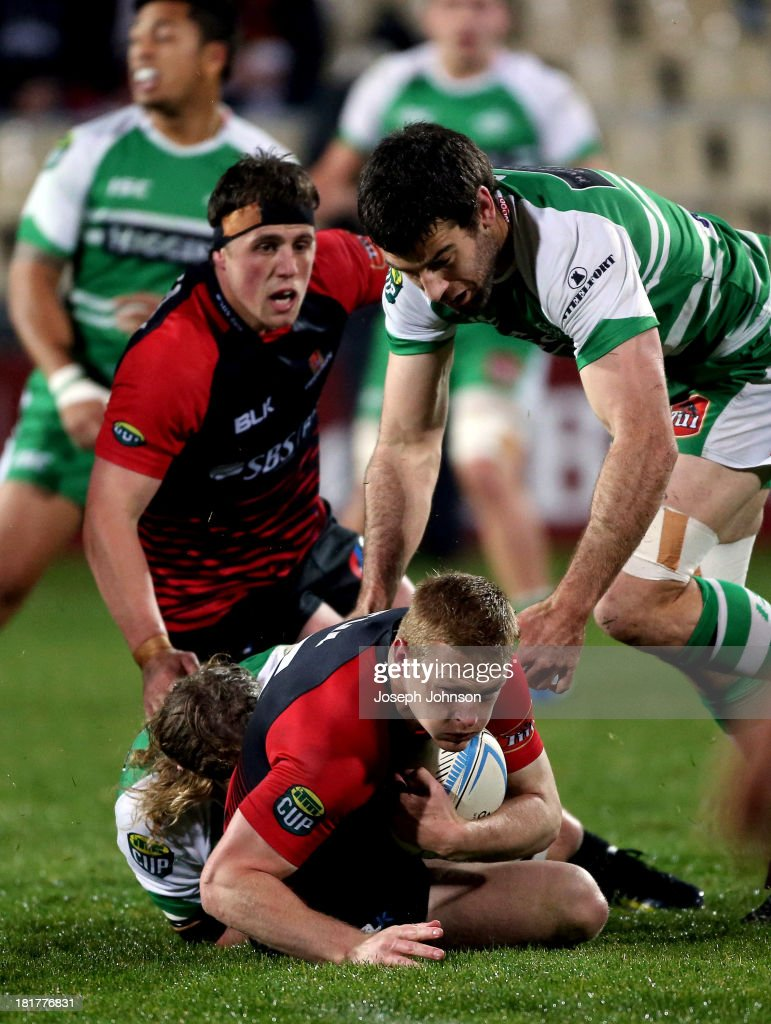 Johnny McNicholl of Canterbury is tackled by James Oliver and Nick Crosswell during the round 7 ITM Cup match between Canterbury and Manawatu at AMI Stadium on September 25, 2013 in Christchurch, New Zealand.