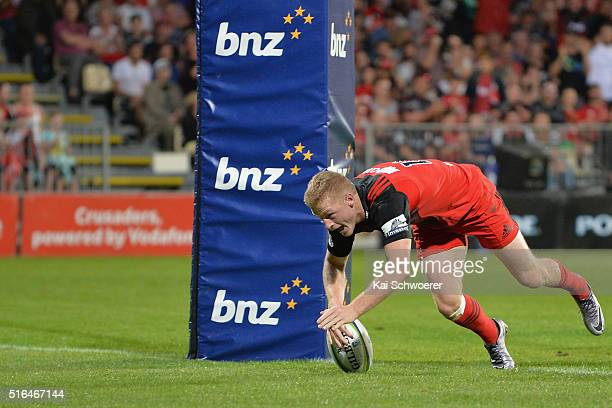 Johnny McNicholl of the Crusaders dives over to score a try during the round four Super Rugby match between the Crusaders and the Kings at AMI...