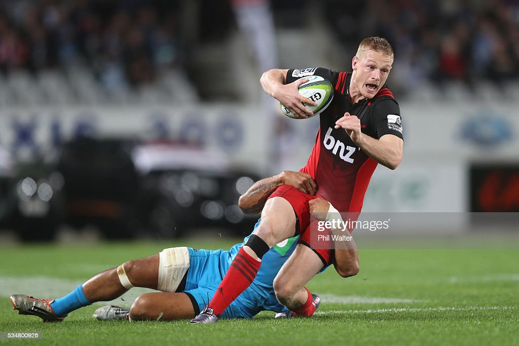 <a gi-track='captionPersonalityLinkClicked' href=/galleries/search?phrase=Johnny+McNicholl&family=editorial&specificpeople=7908985 ng-click='$event.stopPropagation()'>Johnny McNicholl</a> of the Crusaders is tackled by <a gi-track='captionPersonalityLinkClicked' href=/galleries/search?phrase=George+Moala&family=editorial&specificpeople=7060971 ng-click='$event.stopPropagation()'>George Moala</a> of the Blues during the round 14 Super Rugby match between the Blues and the Crusaders at Eden Park on May 28, 2016 in Auckland, New Zealand.