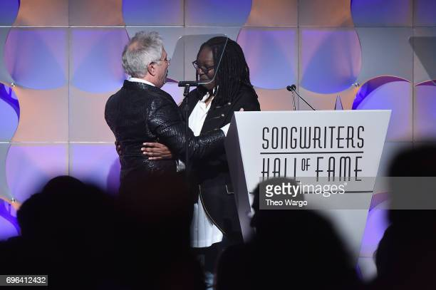 Johnny Mercer Award Honoree Alan Menken and Whoopi Goldberg speak onstage at the Songwriters Hall Of Fame 48th Annual Induction and Awards at New...