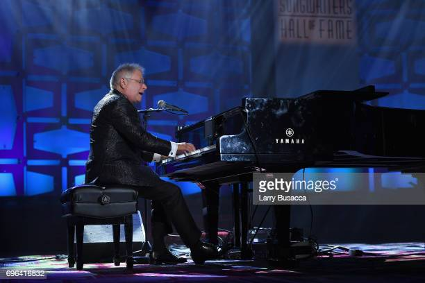 Johnny Mercer Award Honoree Alan Menken performs onstage at the Songwriters Hall Of Fame 48th Annual Induction and Awards at New York Marriott...