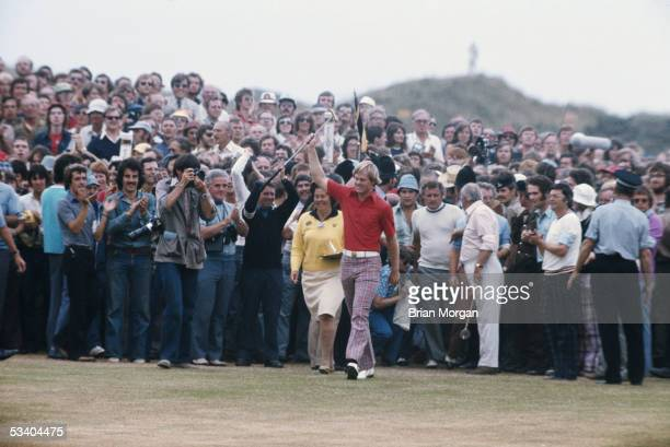 Johnny Miller of the USA acknowledges the crowd on the 18th hole during the British Open 1976 held in July 1976 at the Royal Birkdale in Southport...
