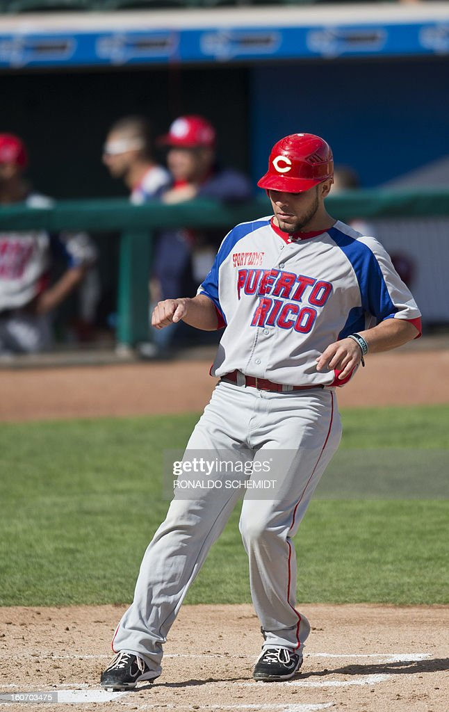Johnny Monell of Criollos de Caguas of Puerto Rico, is safe in home base in a game against Leones del Escogido of Dominican Republic, during the 2013 Caribbean baseball series, on February 4, 2013, in Hermosillo, Sonora State, in the northern of Mexico. AFP PHOTO/Ronaldo Schemidt
