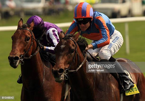 Johnny Murtagh and Alessandro Volta get the better of the David McAbe ridden King Of Rome to come home and land The totesportcom Derby Trial Stakes...