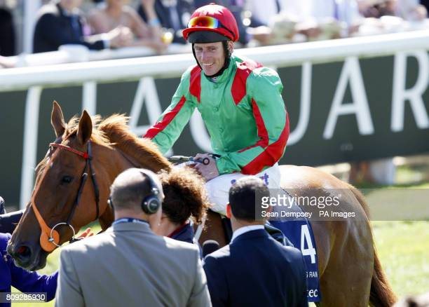 Johnny Murtagh celebrates after winning on Dancing Rain in the Investec Oaks during Ladies Day at the Investec Derby Festival Epsom Downs Racecourse