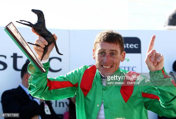 Johnny Murtagh celebrates with his trophy after riding Dancing Rain to victory in The Investec Oaks