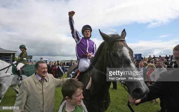 Johnny Murtagh crosses the line on Mastercraftsman to win the Boylesportscom Irish 2000 Guineas during the Boylesportscom Irish 2000 Guineas Day at...