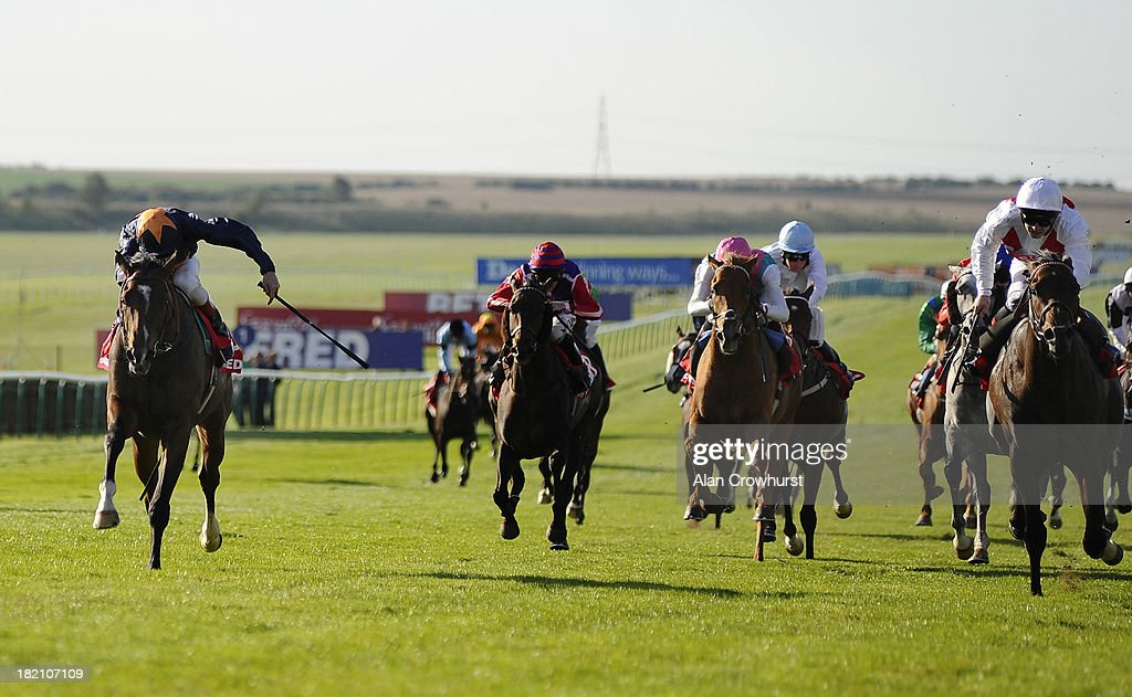 Johnny Murtagh riding Educate win The Betfred Cambridgeshire at Newmarket racecourse on September 28 2013 in Newmarket England