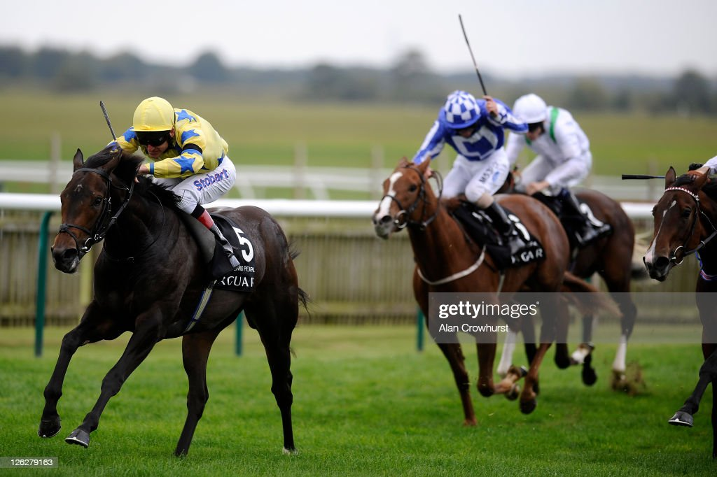 Johnny Murtagh riding Lightening Pearl win The Jaguar Cars Cheveley Park Stakes at Newmarket racecourse on September 24, 2011 in Newmarket, England.