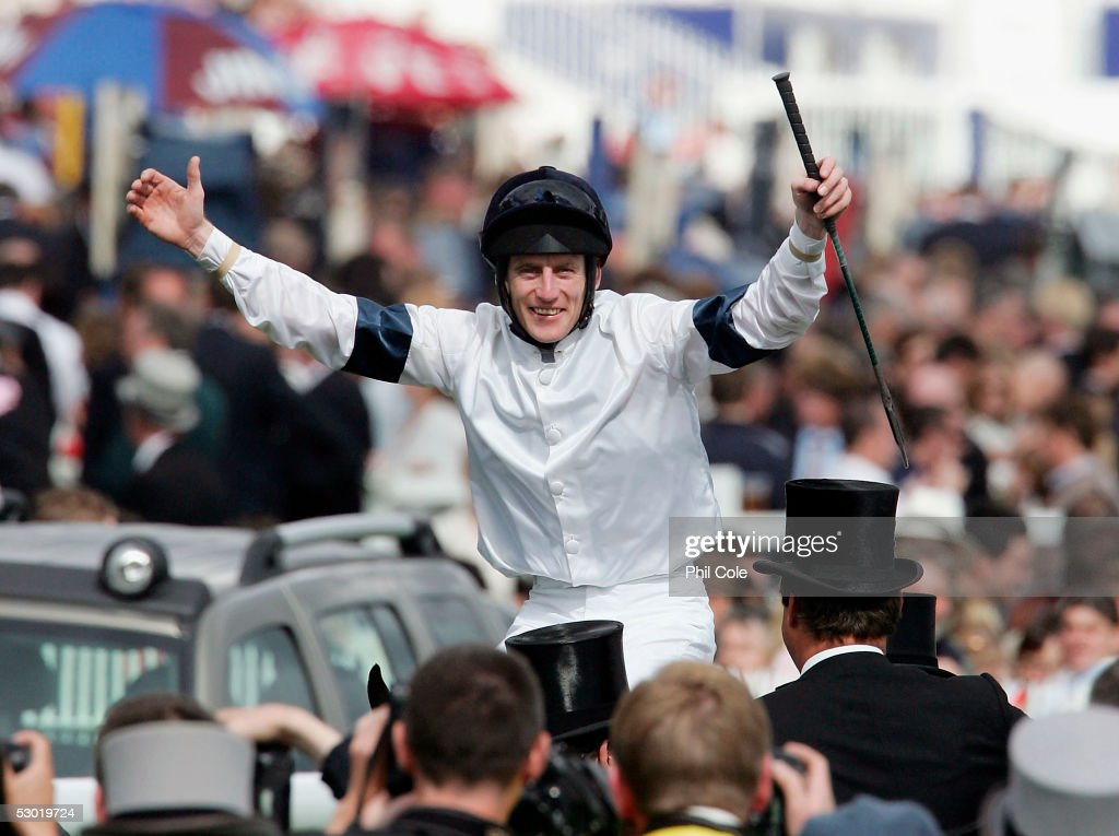 Johnny Murtagh riding Motivator celebrates after winning the Vodafone Derby Race held at Epsom Downs Racecourse on June 4, 2005 in Epsom, England.