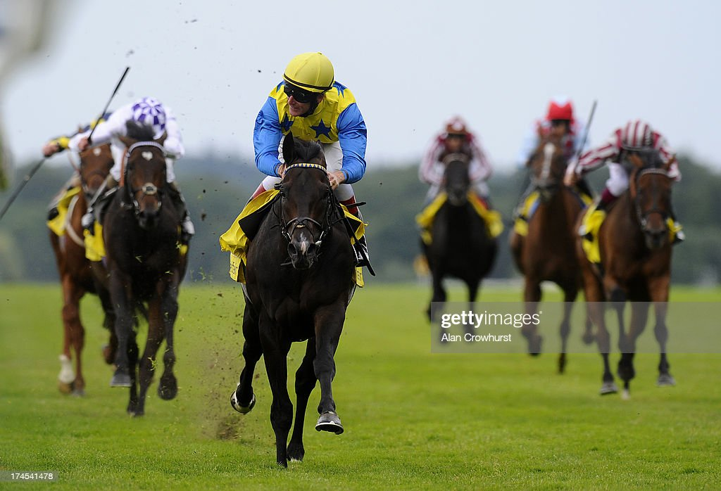 Johnny Murtagh riding Novellist win The King George VI and Queen Elizabeth Stakes at Ascot racecourse on July 27, 2013 in Ascot, England.