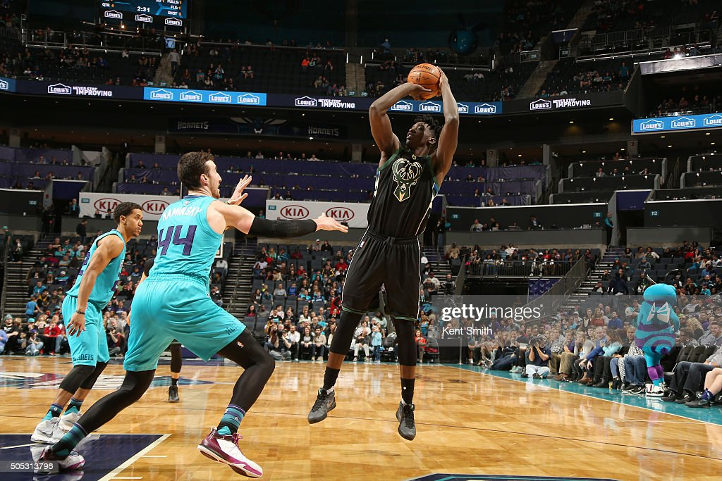 Johnny O'Bryant III #77 of the Milwaukee Bucks shoots the ball against the Charlotte Hornets on January 16, 2016 at Time Warner Cable Arena in Charlotte, North Carolina.