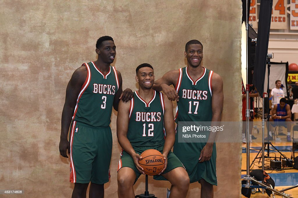 Johnny O'Bryant #3, <a gi-track='captionPersonalityLinkClicked' href=/galleries/search?phrase=Jabari+Parker&family=editorial&specificpeople=9330340 ng-click='$event.stopPropagation()'>Jabari Parker</a> #12m and <a gi-track='captionPersonalityLinkClicked' href=/galleries/search?phrase=Damien+Inglis&family=editorial&specificpeople=10908706 ng-click='$event.stopPropagation()'>Damien Inglis</a> #17 of the Milwaukee Bucks poses for a portrait during the 2014 NBA rookie photo shoot on August 3, 2014 at the Madison Square Garden Training Facility in Tarrytown, New York.