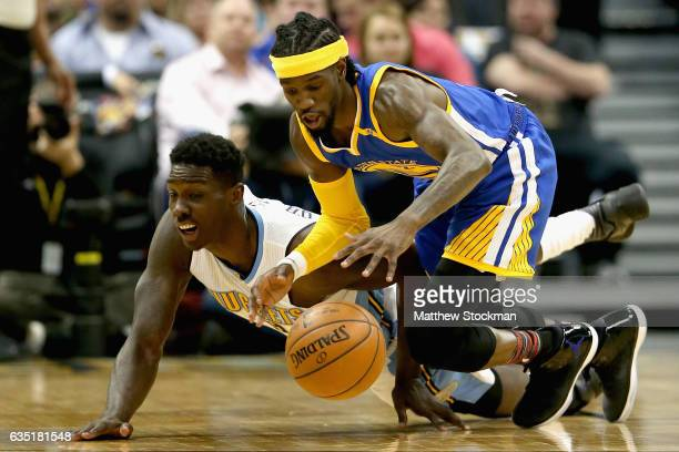 Johnny O'Bryant of the Denver Nuggets and Briante Weber of the Golden State Warriors fight for a loose ball at the Pepsi Center on February 13 2017...