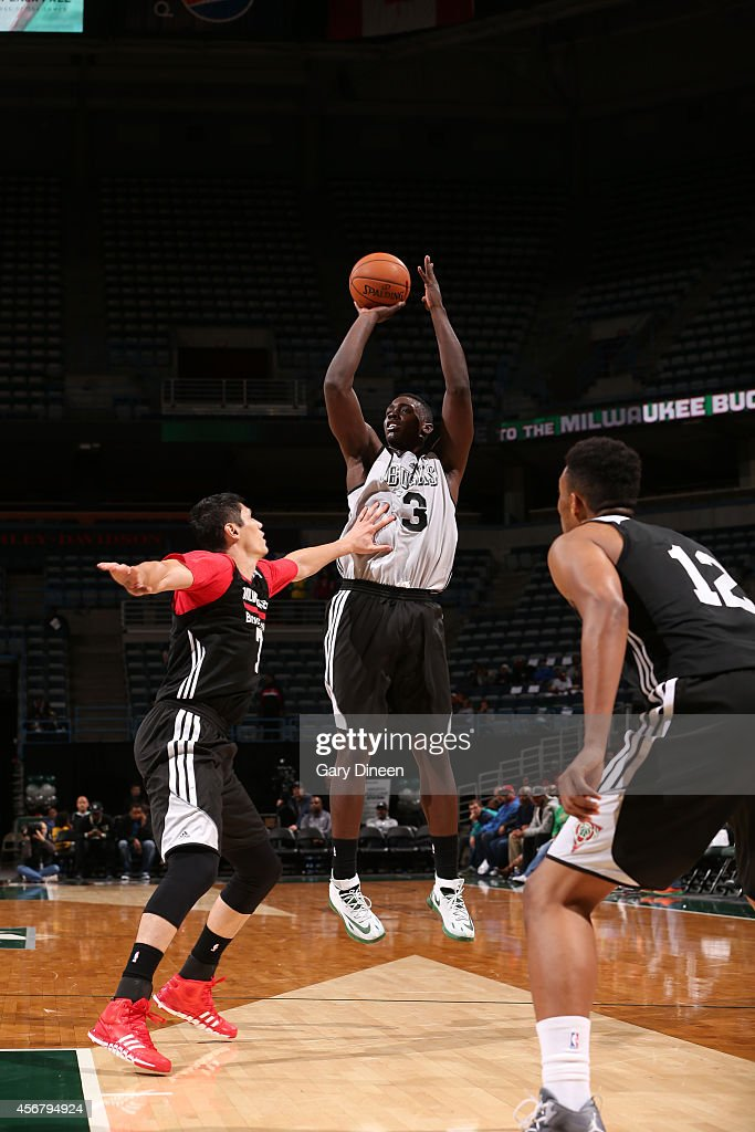 Johnny O'Bryant #3 of the Milwaukee Bucks shoots against teammate <a gi-track='captionPersonalityLinkClicked' href=/galleries/search?phrase=Ersan+Ilyasova&family=editorial&specificpeople=557070 ng-click='$event.stopPropagation()'>Ersan Ilyasova</a> #7 during the 2014 Milwaukee Bucks Fan Fest and Open Practice on October 4, 2014 at the BMO Harris Bradley Center in Milwaukee, Wisconsin.
