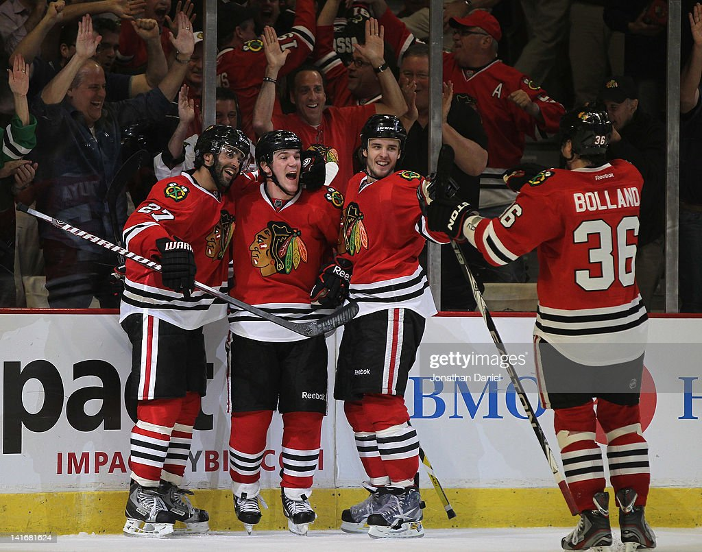 Johnny Oduya Andrew Shaw Niklas Hjalmarsson and Dave Bolland celebrate Shaw's winning goal against the Chicago Blackhawks of the Vancouver Canucks at...