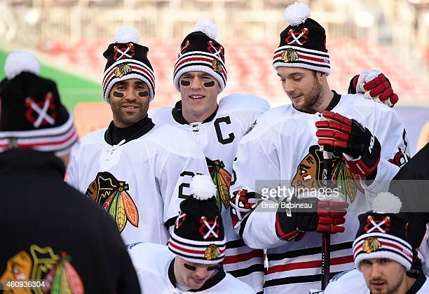 Johnny Oduya Jonathan Toews and David Rundblad of the Chicago Blackhawks pose for a team photo during practice day prior to the 2015 Bridgestone NHL...