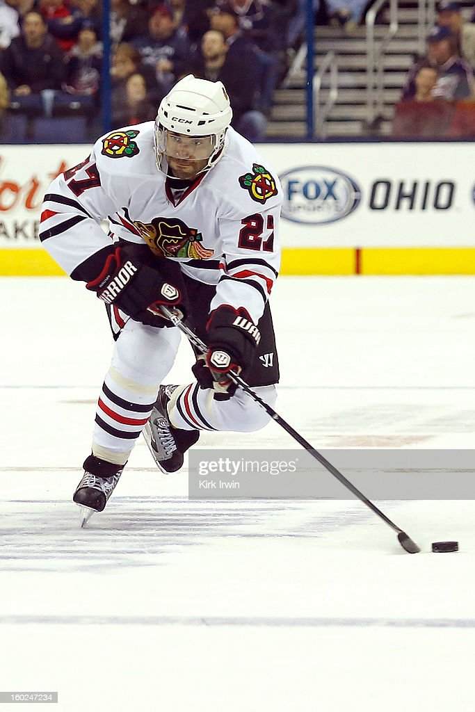 Johnny Oduya #27 of the Chicago Blackhakws skates with the puck during the game against the Columbus Blue Jackets on January 26, 2013 at Nationwide Arena in Columbus, Ohio.