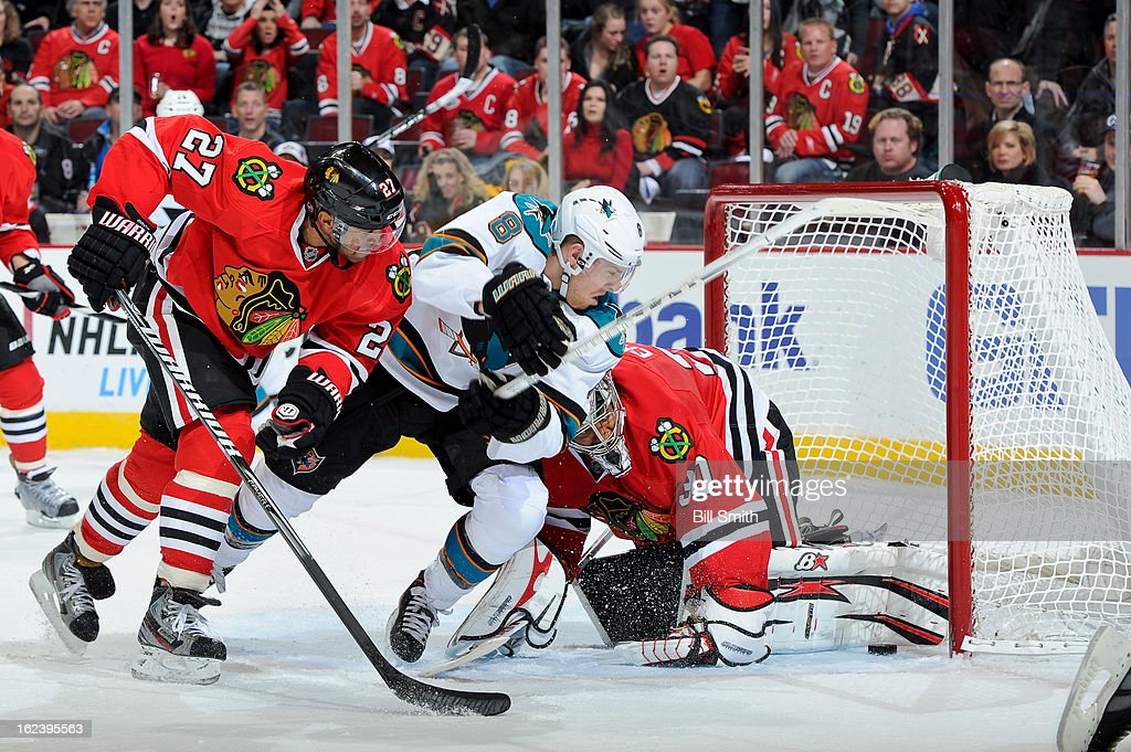 <a gi-track='captionPersonalityLinkClicked' href=/galleries/search?phrase=Johnny+Oduya&family=editorial&specificpeople=3944055 ng-click='$event.stopPropagation()'>Johnny Oduya</a> #27 of the Chicago Blackhawks and <a gi-track='captionPersonalityLinkClicked' href=/galleries/search?phrase=Joe+Pavelski&family=editorial&specificpeople=687042 ng-click='$event.stopPropagation()'>Joe Pavelski</a> #8 of the San Jose Sharks skate by Blackhawks' goalie <a gi-track='captionPersonalityLinkClicked' href=/galleries/search?phrase=Ray+Emery&family=editorial&specificpeople=218109 ng-click='$event.stopPropagation()'>Ray Emery</a> #30 as the Sharks score a goal in during the NHL game on February 22, 2013 at the United Center in Chicago, Illinois.