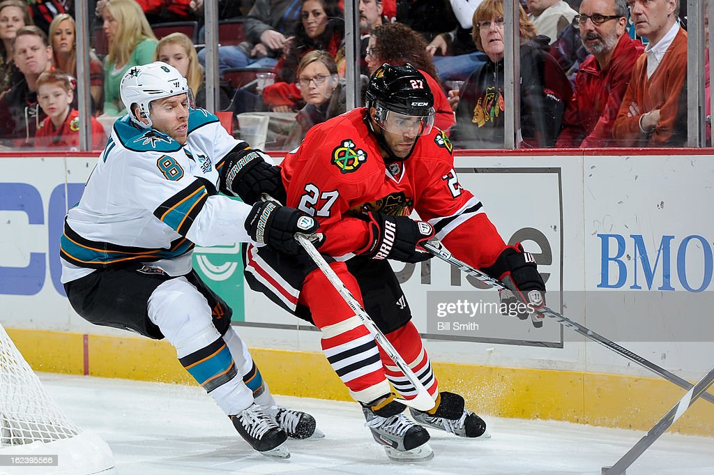 <a gi-track='captionPersonalityLinkClicked' href=/galleries/search?phrase=Johnny+Oduya&family=editorial&specificpeople=3944055 ng-click='$event.stopPropagation()'>Johnny Oduya</a> #27 of the Chicago Blackhawks and <a gi-track='captionPersonalityLinkClicked' href=/galleries/search?phrase=Joe+Pavelski&family=editorial&specificpeople=687042 ng-click='$event.stopPropagation()'>Joe Pavelski</a> #8 of the San Jose Sharks battle for the puck during the NHL game on February 22, 2013 at the United Center in Chicago, Illinois.