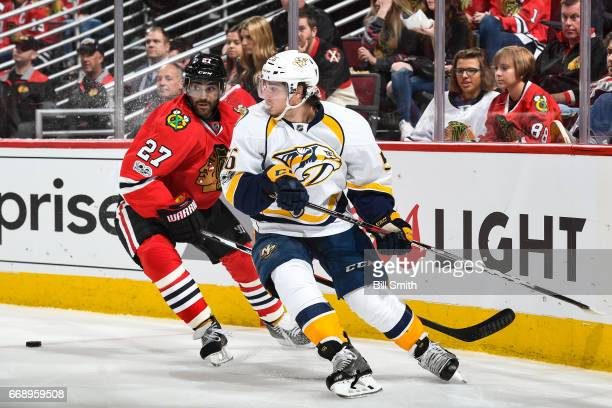 Johnny Oduya of the Chicago Blackhawks and Kevin Fiala of the Nashville Predators chase the puck in the second period in Game Two of the Western...