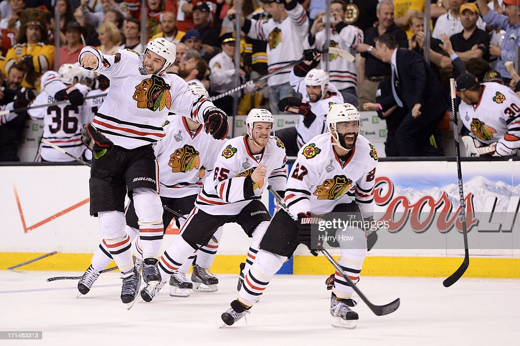 <a gi-track='captionPersonalityLinkClicked' href=/galleries/search?phrase=Johnny+Oduya&family=editorial&specificpeople=3944055 ng-click='$event.stopPropagation()'>Johnny Oduya</a> #27 of the Chicago Blackhawks celebrates after defeating the Boston Bruins in Game Six of the 2013 NHL Stanley Cup Final at TD Garden on June 24, 2013 in Boston, Massachusetts. The Chicago Blackhawks defeated the Boston Bruins 3-2.