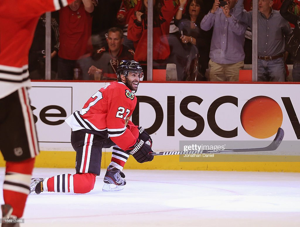 <a gi-track='captionPersonalityLinkClicked' href=/galleries/search?phrase=Johnny+Oduya&family=editorial&specificpeople=3944055 ng-click='$event.stopPropagation()'>Johnny Oduya</a> #27 of the Chicago Blackhawks celebrates his third period goal against the Detroit Red Wings in Game One of the Western Conference Semifinals during the 2013 NHL Stanley Cup Playoffs at the United Center on May 15, 2013 in Chicago, Illinois. The Blackhawks defeated the Red Wings 4-1.