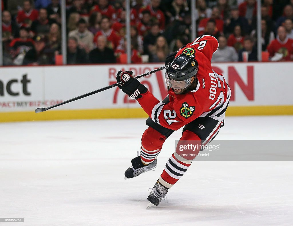 <a gi-track='captionPersonalityLinkClicked' href=/galleries/search?phrase=Johnny+Oduya&family=editorial&specificpeople=3944055 ng-click='$event.stopPropagation()'>Johnny Oduya</a> #27 of the Chicago Blackhawks passes against the Minnesota Wild at the United Center on March 5, 2013 in Chicago, Illinois. The Blackhawks defeated the Wild 5-3.