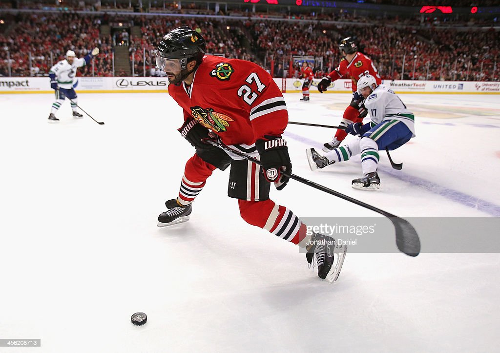 <a gi-track='captionPersonalityLinkClicked' href=/galleries/search?phrase=Johnny+Oduya&family=editorial&specificpeople=3944055 ng-click='$event.stopPropagation()'>Johnny Oduya</a> #27 of the Chicago Blackhawks readies to shoot against the Vancouver Canucks at the United Center on December 20, 2013 in Chicago, Illinois. The Canucks defeated the Blackhawks 3-2 in a shootout.