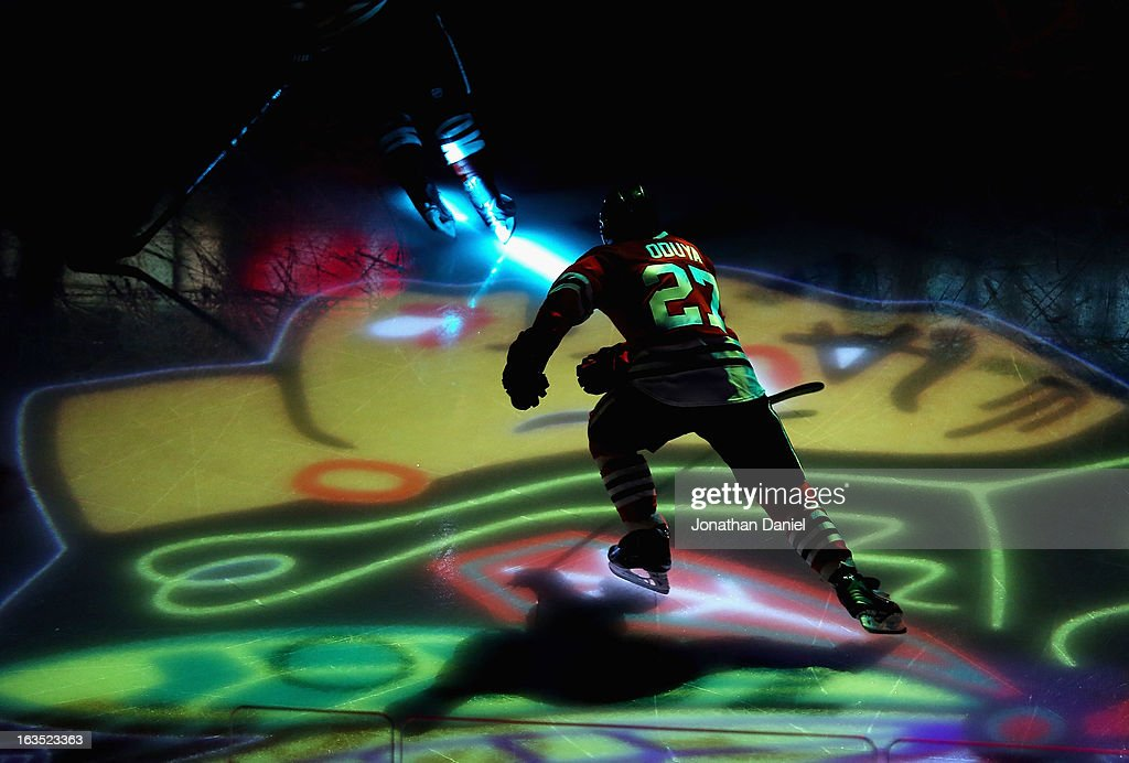 <a gi-track='captionPersonalityLinkClicked' href=/galleries/search?phrase=Johnny+Oduya&family=editorial&specificpeople=3944055 ng-click='$event.stopPropagation()'>Johnny Oduya</a> #27 of the Chicago Blackhawks skates during player introductions before a game against the Edmonton Oilers at the United Center on March 10, 2013 in Chicago, Illinois. The Oilers defeated the Blackhawks 6-5.