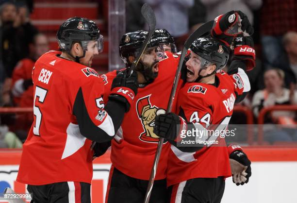 Johnny Oduya of the Ottawa Senators celebrates his third period goal against the Colorado Avalanche with teammates Cody Ceci and JeanGabriel Pageau...
