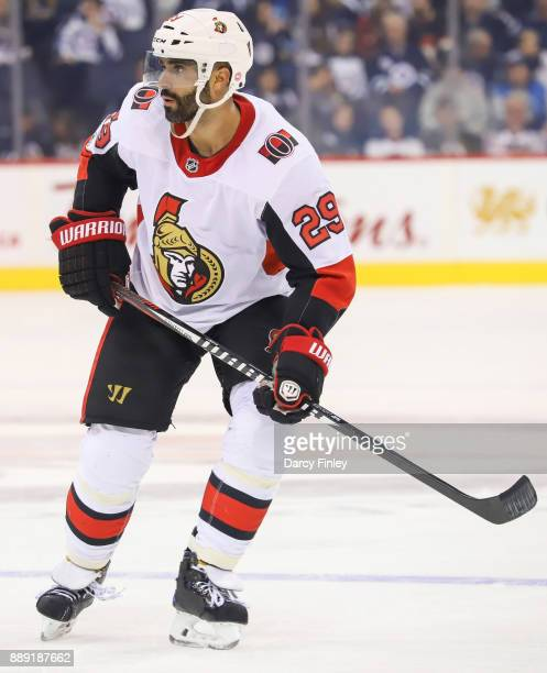Johnny Oduya of the Ottawa Senators keeps an eye on the play during third period action against the Winnipeg Jets at the Bell MTS Place on December 3...