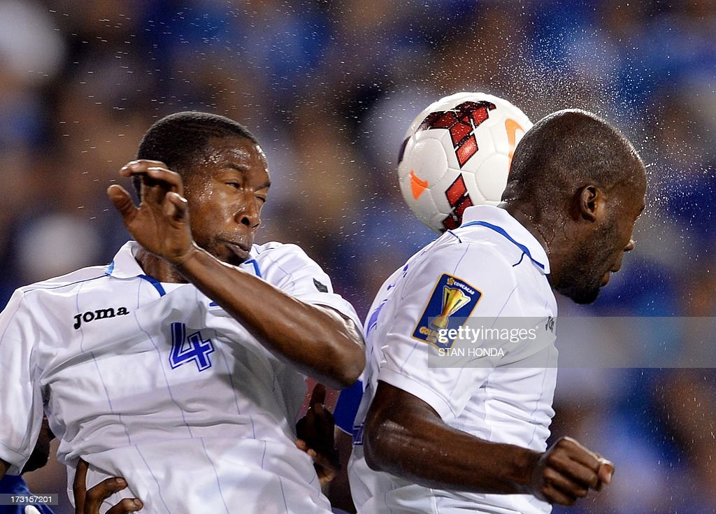 Johnny Palacios (L) and Osman Chavez (R) of Honduras during the 2013 CONCACAF Gold Cup match against Haiti July 8, 2013 at Red Bull Stadium in Harrison, New Jersey won by Honduras, 2-0. AFP PHOTO/Stan HONDA