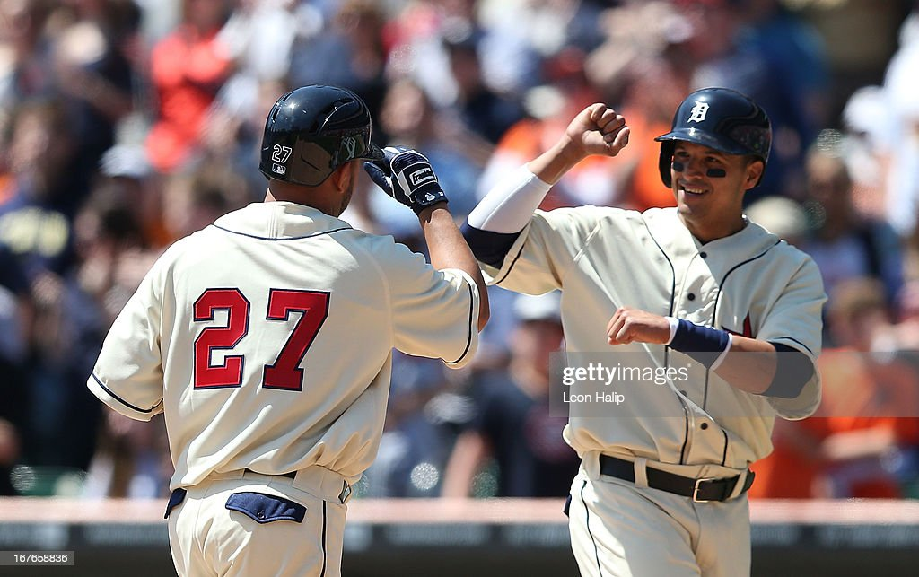 Johnny Peralta #27 of the Detroit Tigers is congratulated at home plate by teammate Victor Martinez #41 after hitting a two run home run during the second inning of the game against the Atlanta Braves at Comerica Park on April 27, 2013 in Detroit, Michigan.