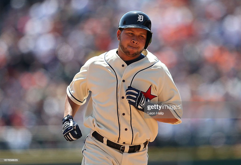 Johnny Peralta #27 of the Detroit Tigers rounds second base after hitting a two run home run scoring Victor Martinez #41 during the second inning of the game against the Atlanta Braves at Comerica Park on April 27, 2013 in Detroit, Michigan.