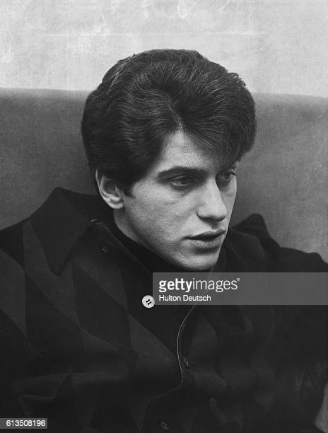 sings rock 'n' roll and gets away with it Johnny Rivers the American rock and roll singer Johnny Rivers is a young man with a very chic following in...