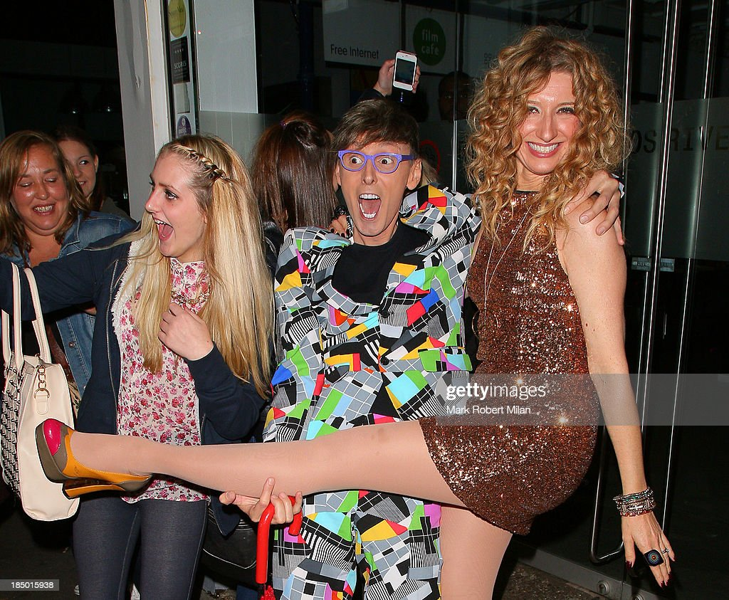 Johnny Robinson and Melanie Masson leaving the Riverside studios after filming Celebrity Juice on October 16, 2013 in London, England.