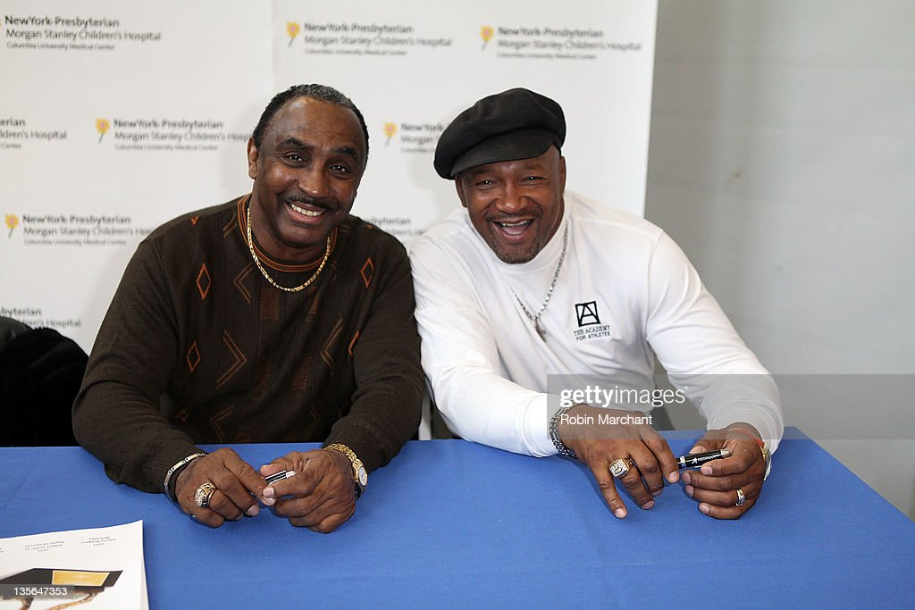 Johnny Rodgers and <a gi-track='captionPersonalityLinkClicked' href=/galleries/search?phrase=Mike+Rozier&family=editorial&specificpeople=622828 ng-click='$event.stopPropagation()'>Mike Rozier</a> deliver toys to children at the NewYork-Presbyterian Morgan Stanley Children's Hospital on December 12, 2011 in New York City.