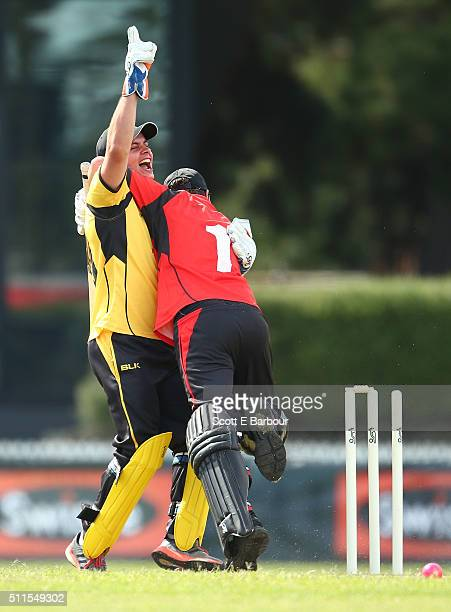 Johnny Ruffo celebrates with Samuel Johnson after dismissing Johnson during the Medibank Melbourne Celebrity Twenty20 match at North Port Oval on...