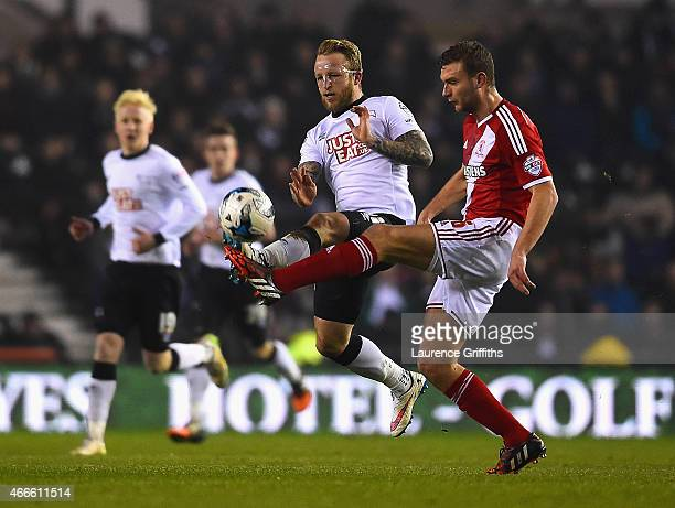 Johnny Russell of Derby and Ben Gibson of Middlesbrough battle for the ball during the Sky Bet Championship match between Derby County and...