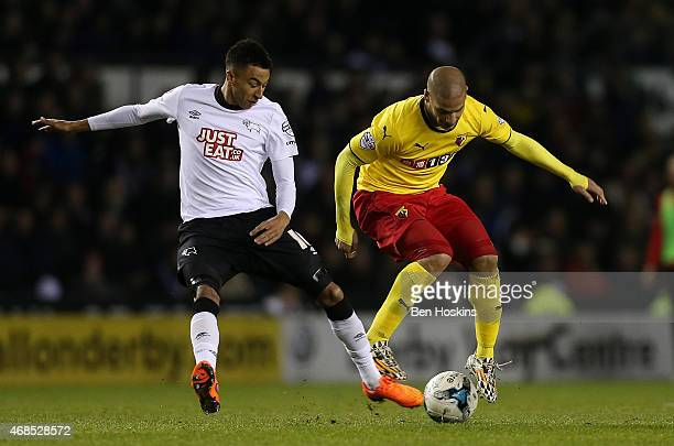 Johnny Russell of Derby battles with Adlene Guedioura of Watford during the Sky Bet Championship match between Derby County and Watford at iPro...