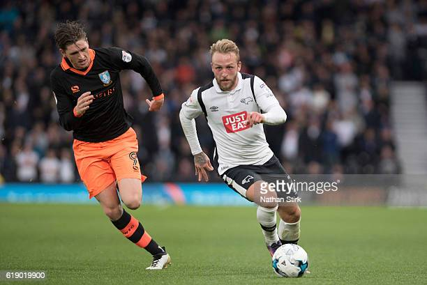 Johnny Russell of Derby County and Adam Reach of Sheffield Wednesday in action during the Sky Bet Championship match between Derby County and...