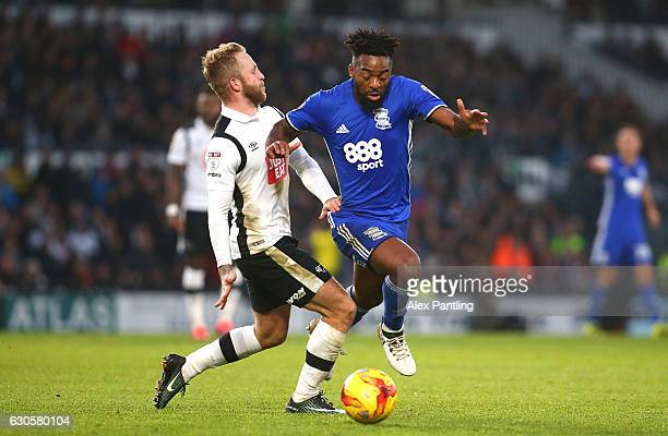 Johnny Russell of Derby County and Jaques Maghoma of Birmingham City in action during the Sky Bet Championship match between Derby County and...